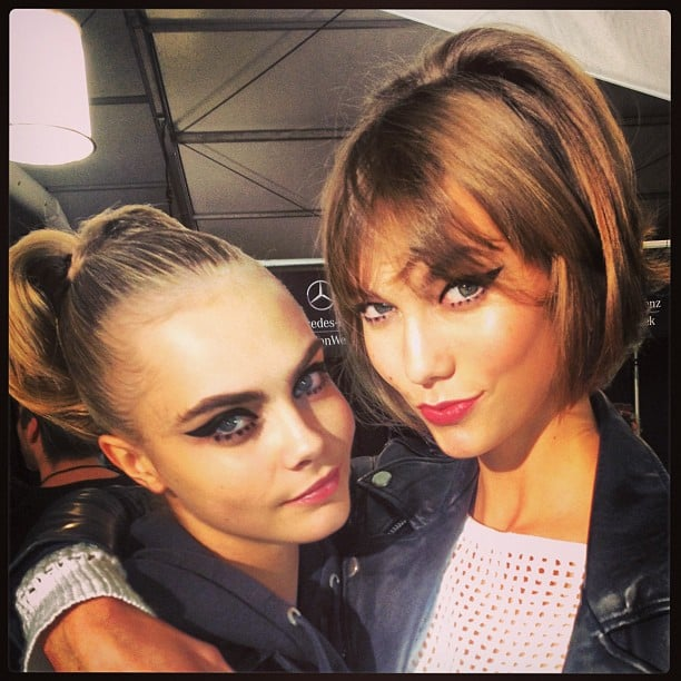 Cara Delevingne and Karlie Kloss sported cat-eye makeup backstage at Anna Sui. Source: Twitter user Caradelevingne