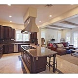 Kylie can cook for friends in this open-concept kitchen that looks out on the family room.