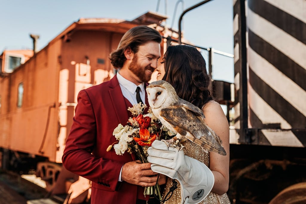 """The designers at The Wild Rumpus Collective had a vision to create a romantic Harry Potter-themed styled shoot that makes you feel like you've stepped straight off the Hogwarts Express. Photographed in Temple, TX, their vision became a magical reality. The whimsical fantasy shoot featured a look-alike Hogwarts Express train, a live """"Hedwig"""" owl, a sorting-hat-inspired cake, colors from the house of Gryffindor, an amortentia love spell on each table, as well as butterbeer and other fun magical details. One of the designers behind it all wrote, """"I am thrilled with how the shoot came out and totally enjoyed submerging into Potter world!"""" If you love the wizarding world of Harry Potter and wish to incorporate it into your big day, catch all the details ahead.       Related:                                                                                                           This Harry Potter Slytherin Wedding Is Wicked Enchanting"""