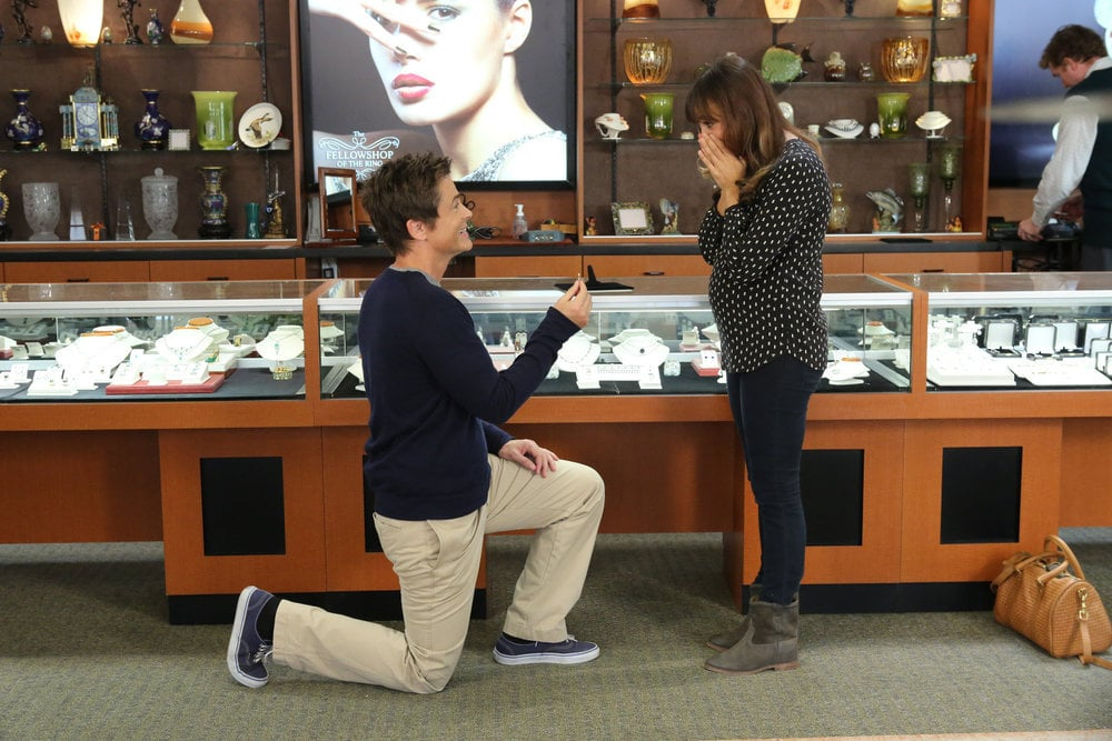 Chris gets down on one knee.