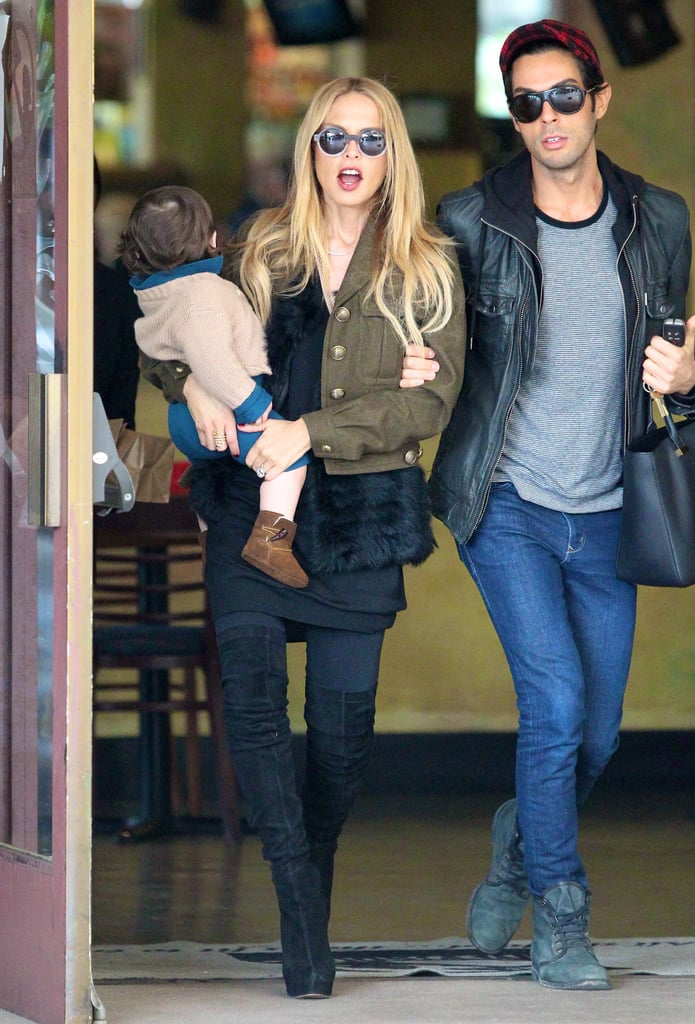 Rachel Zoe paired a strong military jacket with slick black bottoms while on the go with baby Skyler.