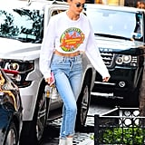 Gigi threw it back to the '90s with a Nikelodeon sweatshirt to top her high-waisted jeans.