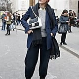 This ensemble has all the makings of tomboy cool with a perfect dose of the trends via a metallic collar necklace and black and white Chanel.