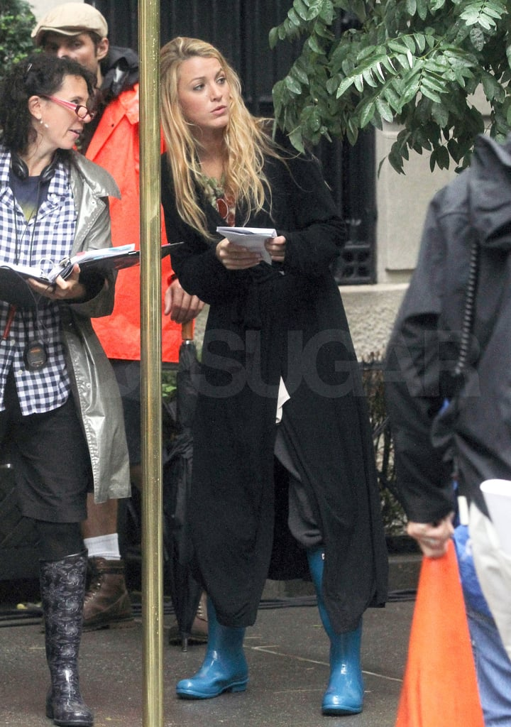 Blake Lively arrived on set wearing blue rain boots.