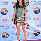 Miranda Cosgrove wore a metallic Collette Dinnigan dress, Stella McCartney shoes, and Judith Leiber clutch.