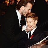 David Beckham gave his son Romeo a sweet kiss at the world premiere of The Class of '92 in London.
