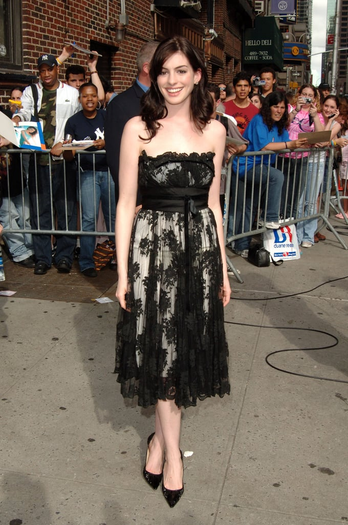 June 2006 at the Late Show With David Letterman in a frilly black lace strapless cocktail dress that represents Anne's feminine style.