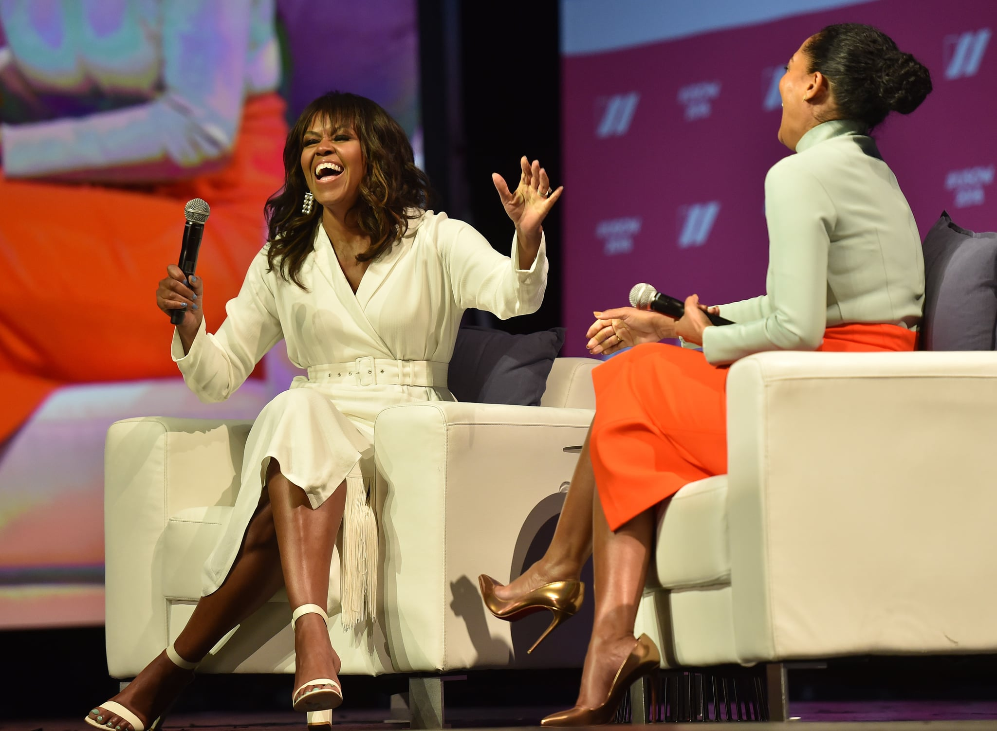 Former US first lady Michelle Obama (L) and actress/activist Tracee Lee Ross attend the United State of Women Summit at the Shrine Auditorium in Los Angeles, on May 5, 2018. (Photo by CHRIS DELMAS / AFP)        (Photo credit should read CHRIS DELMAS/AFP/Getty Images)
