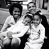 "Michelle Obama shared a throwback photo of the first family, writing, ""#HappyFathersDay, Barack! Our girls are lucky to have such a great Dad."" Source: Instagram user michelleobama"