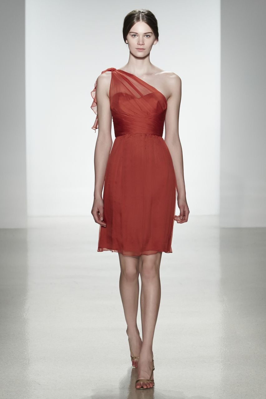 Amsale chiffon one-shoulder knee-length bridesmaid dress in spice Photo courtesy of Amsale