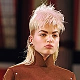 """Guido and his team cut 34 wigs individually for each model to work with her face shape on-site at the show, explaining that he wanted to """"make them look as good as possible so it's like a haircut on each girl."""" Unlike other shows he's worked on this season like Marc Jacobs, these were inexpensive hairpieces as opposed to lace-front wigs."""