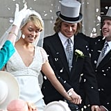 Olivia Wilde and Chris Hemsworth exited a church filming a wedding scene on the London set of Rush.