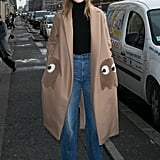 With a Tucked-In Turtleneck, High-Waisted Jeans, and a Funky Coat