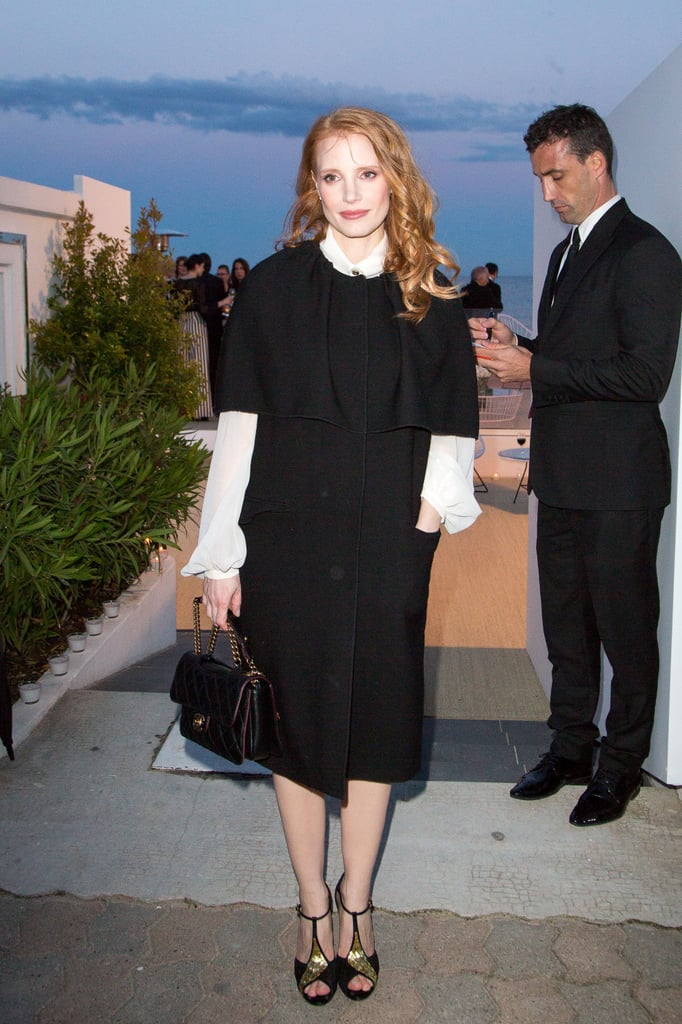 Jessica Chastain stuck to a black-and-white palette, with a pop of gold Roger Vivier sandals, at the Vanity Fair and Chanel dinner.