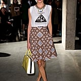 Poppy Delevingne countered an on-trend t-shirt and a graphic-print skirt with more classically feminine-feeling t-strap sandals.