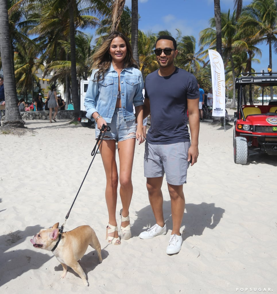 Chrissy Teigen and John Legend took their dog for a walk on the beach in Miami on Thursday.