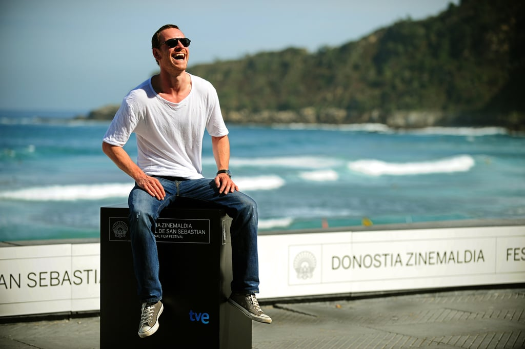 Michael Fassbender cracked himself up at a photocall during the San Sebastian Film Festival in September 2011.