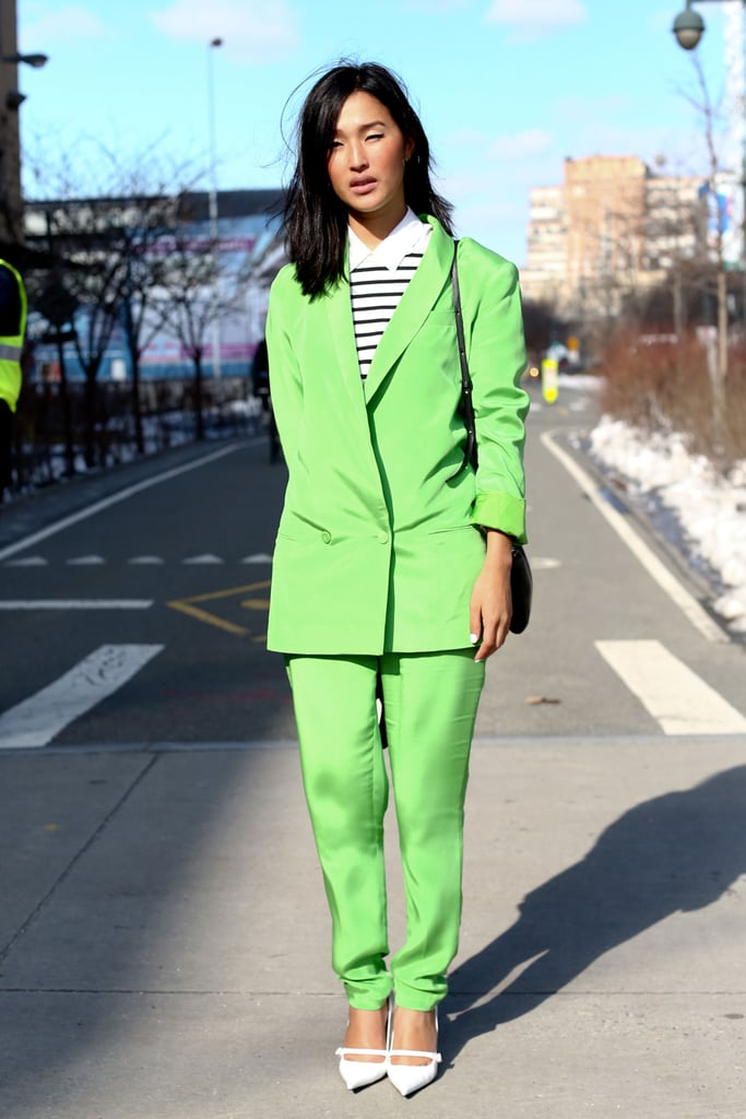 This showgoer got a head start on Spring in lime-green suiting and crisp white heels.