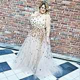 """""""[Nicolette] wanted it to still feel light because it had so much appliqué, so doing the sheer sleeves and the tulle overlay with the short underskirt was nice. It was playful but still beautiful,"""" says Siriano."""