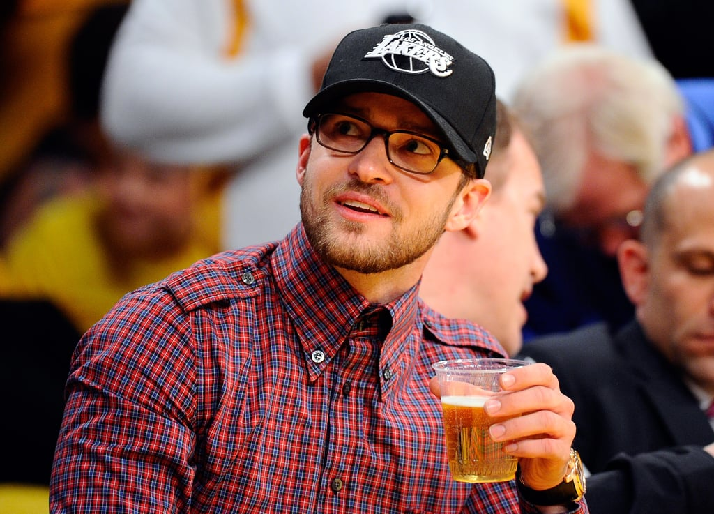 Justin Timberlake enjoyed a beer while sitting courtside at an NBA playoff game in May 2011.