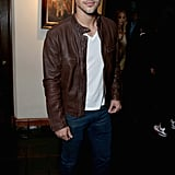 Taylor Lautner wore a leather jacket.