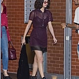 For street style with an edge, Selena wore combat booties with a more feminine, sheer dress.
