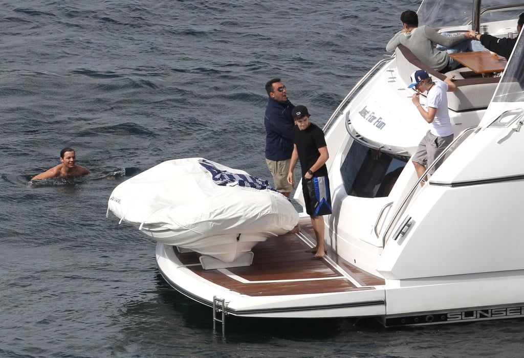 One Direction enjoyed a day of boating and swimming in Australia.