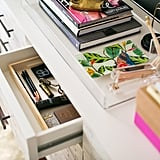 Numerous drawers, trays, and desktop organizers are included so Desi has ample storage for her beauty supplies.