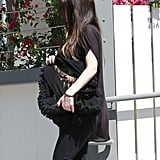 Pregnant Megan Fox Gives Her Baby Bump a Big Hug