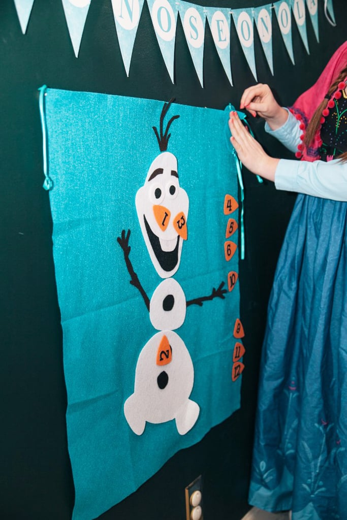 """Playing on the character's tendency to misplace his nose, Anna had the party guests play a game called """"Pin the Nose on Olaf."""" Thanks to Etsy, you can get your hands on this kid-friendly game ($25) also."""