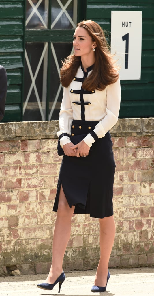 In 2014, Kate opted for a modern take on the look in a navy and cream blouse and skirt by her favorite designer Alexander McQueen.