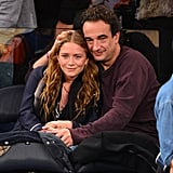 Mary-Kate Olsen and Olivier Sarkozy showed PDA at the game.