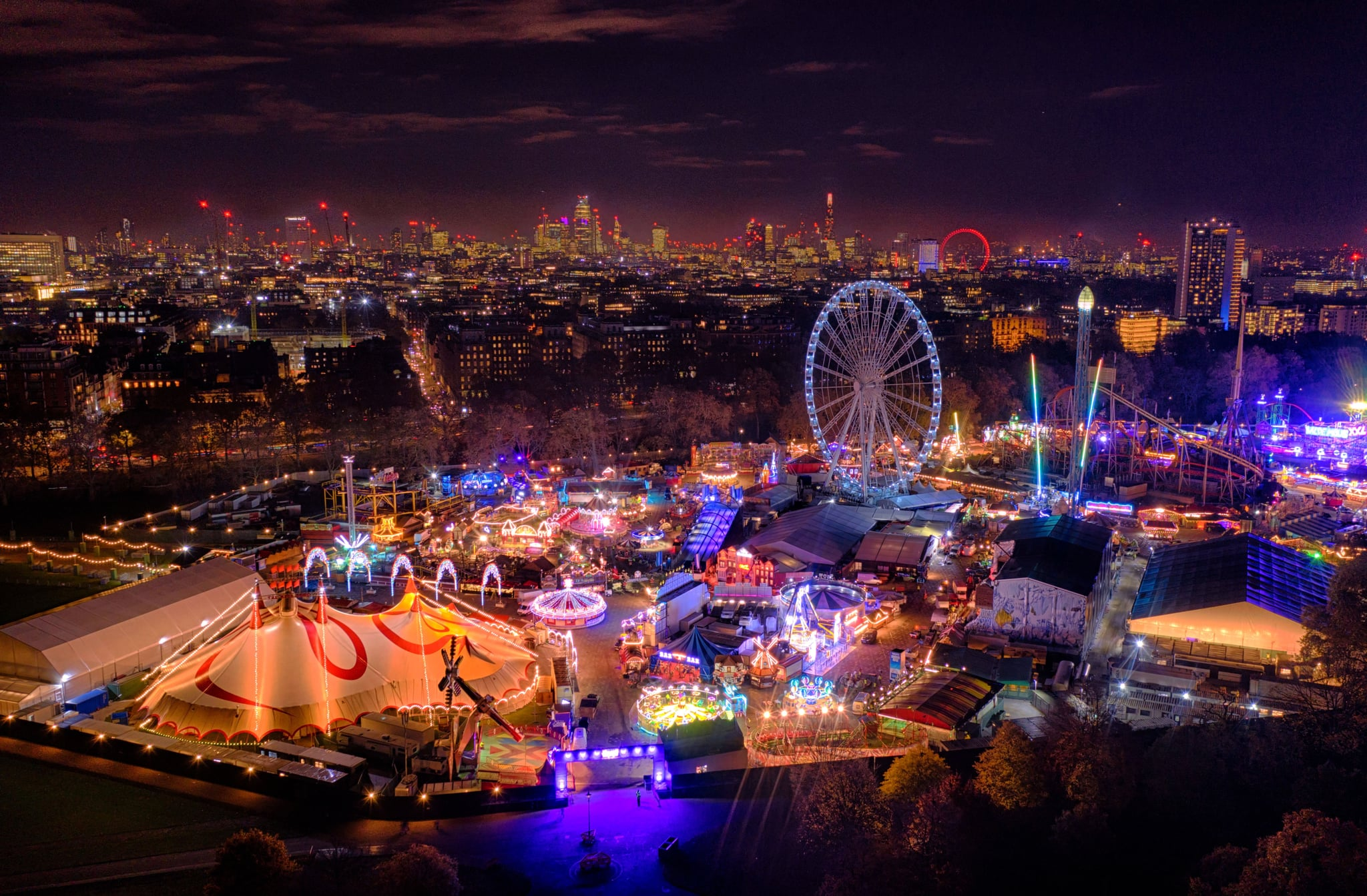 LONDON, UNITED KINGDOM - NOVEMBER 20: Winter Wonderland fair marks the start of the Christmas season in Central London at Hyde Park on November 20, 2019 in London United Kingdom. The Shard and The London Eye can be seen in the background. (Photo by Chris Gorman/Getty Images)
