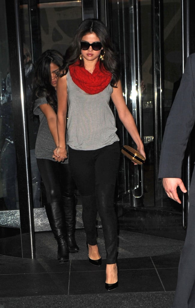 Newly-Single Selena Gomez Holds Hands With a Friend in NYC