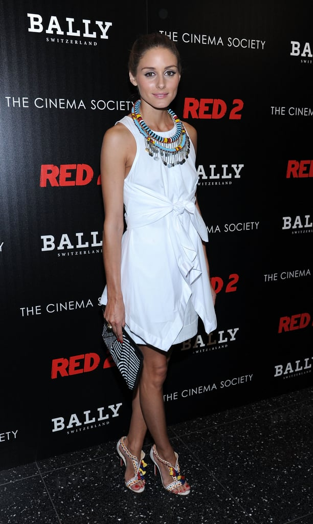 Adding intrigue to a white Alexander Wang dress with bright jewels and unique heels at Summer film screening in 2013.