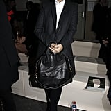 Lily Allen looked very serious at Givenchy where she wore a monochrome ensemble. I love her nightingale bag.