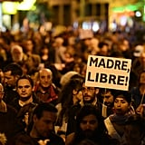 "A woman held up a sign reading, ""Free Mother,"" during a Madrid demonstration."