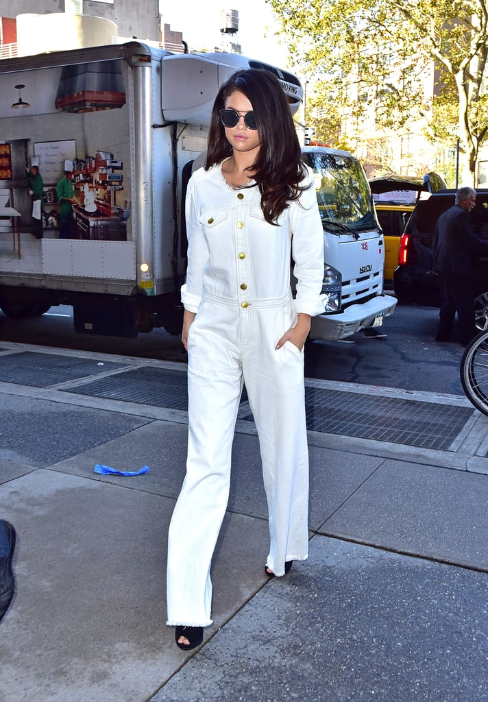 653a0ee659ab Fall staple  a white denim jumpsuit from Etoile Isabel Marant. Selena wore  it with