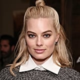 Margot Robbie's lob looks fetching in the half-up style.