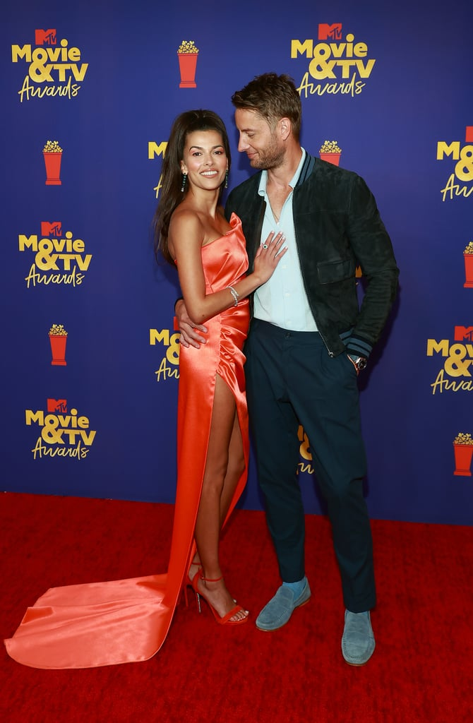 It's been nearly a year since Justin Hartley and Sofia Pernas were confirmed as a couple, and now they're making their red carpet debut. On May 16, the This Is Us actor and his soap star girlfriend stepped out for the MTV Movie and TV Awards in LA looking seriously in love. Justin is presenting during the award show, but made sure to pose for some sweet photos as the festivities kicked off. Justin and Sofia were first spotted together romantically in May 2020 after he filed for divorce from Chrishell Stause, but the two have known each other for years, as they previously costarred on The Young and the Restless in 2015. Check out photos of Justin and Sofia at the 2021 MTV Movie and TV Awards ahead, because this right here is how you do your first red carpet appearance together.      Related:                                                                                                           The Pogues Reunite at the MTV Movie and TV Awards, and Damn, They Look Good