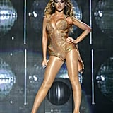 Wearing a body-hugging gold costume by Thierry Mugler while performing at NYC's Madison Square Garden in 2009.