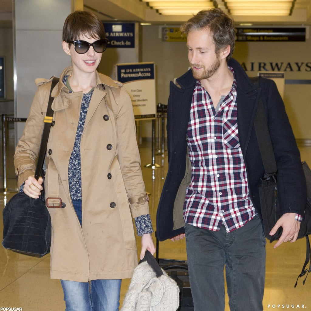 Anne Hathaway wore a khaki trench for her flight.