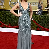 Julia Stiles donned a gray sequin-embellished gown by Amen Couture with Jerome C. Rousseau sandals, retro curls, and a red lip.