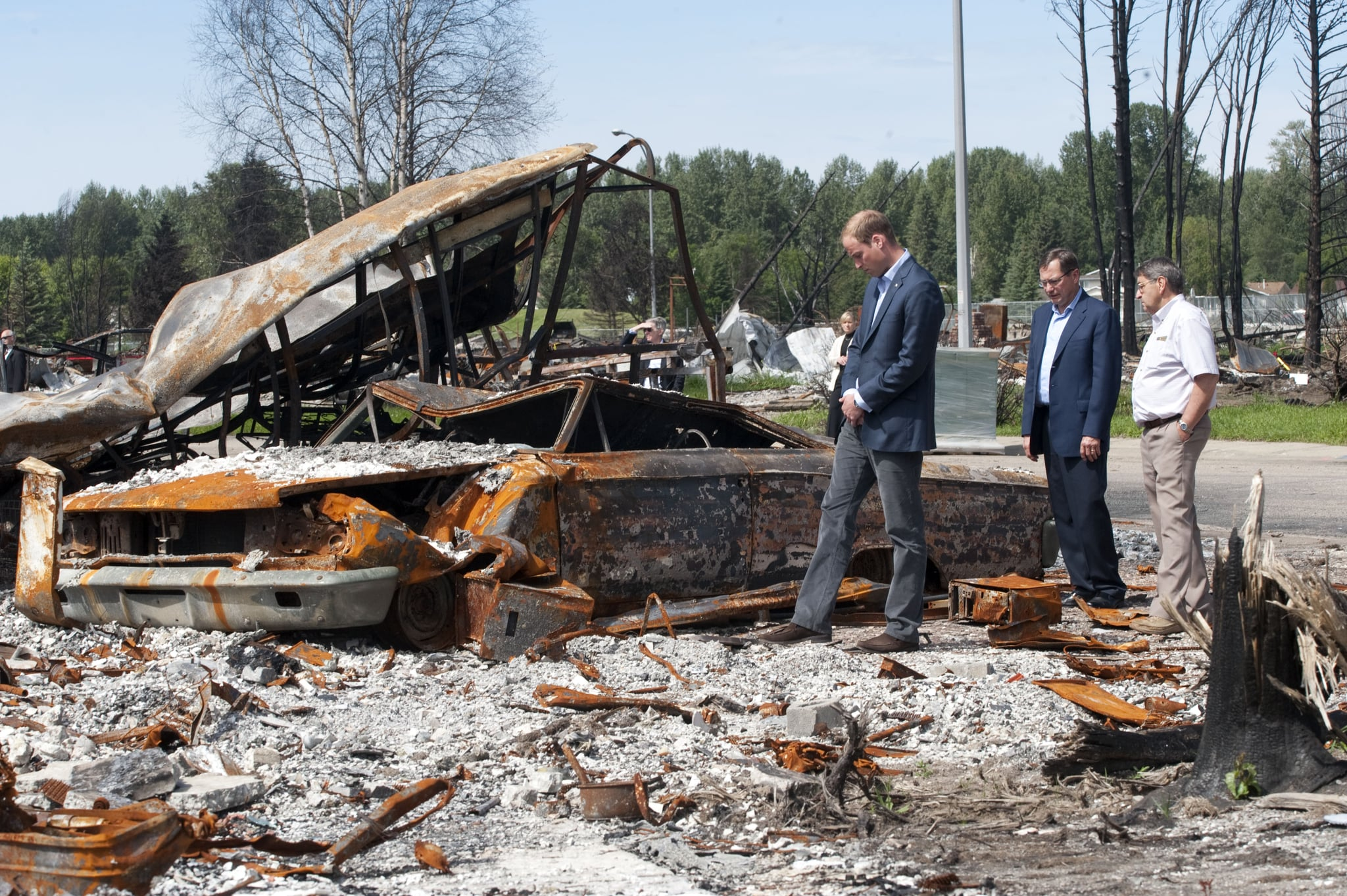 Prince William looks at fire damage in Alberta.