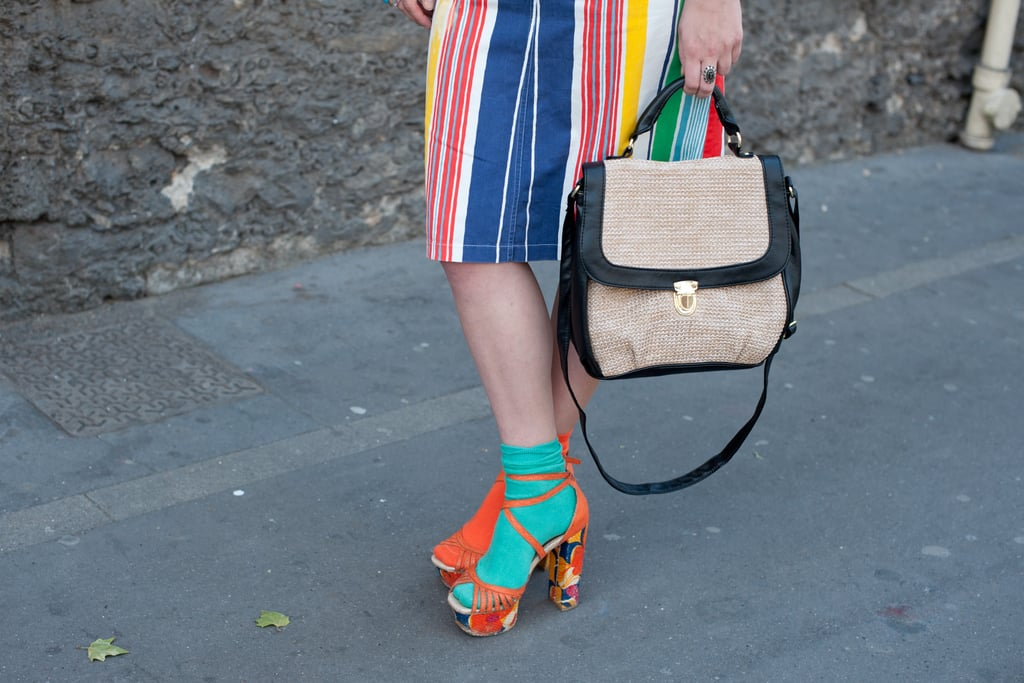 A structured satchel echoed the retro feel of socks and sandals.