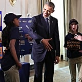 The Girl Scout Troop #1484 from St. Louis, MO, shared some laughs with the president while describing their project — a bin called Eco Bin that can dissolve styrofoam (which can take hundreds of years to decompose) when it's mixed with water. As a result of this experiment, they discovered a sticky substance that they bottled for art projects and are calling GlOo. They've won state awards and a chance to compete for the Global Innovation Award and are now pursuing patents for both projects.
