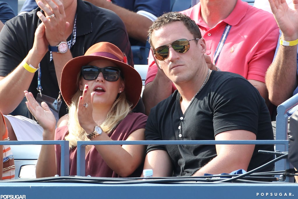 Elisha Cuthbert and her fiancé, Dion Phaneuf, were among the celebrities at the US Open on Saturday. Dion and Elisha announced their engagement earlier this month, and she modeled a huge diamond on her left hand this weekend — how does her ring stack up against other celebrity engagement rings? The pair seem to be enjoying their newly engaged status, though they'll be forced to go their separate ways in upcoming weeks. Elisha's scheduled to resume filming the third season of Happy Endings in LA and Dion's returning to Canada to practice with the Toronto Maple Leafs for the upcoming NHL season.