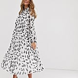 ASOS DESIGN pleated trapeze midi dress with tie neck in splodge print