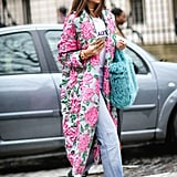 Boldly, with a printed coat, statement bag, and shoes that say you've gone all out
