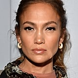 Jennifer Lopez looked sexy in a snake-encrusted Lanvin dress at a press conference to announce her Mega tour.